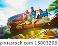 People Having Fun On Rollercoaster In Park 18003299