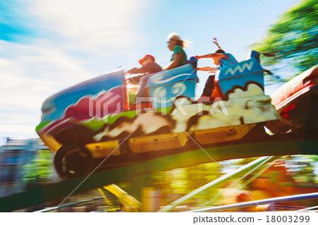 People Having Fun On Rollercoaster In Park 18003299