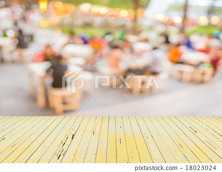 blur image of people sit on the table with festival bokeh lights 18023024
