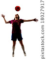 silhouette of girl playing football 18027917