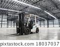 Forklift loader in large modern storehouse 18037037