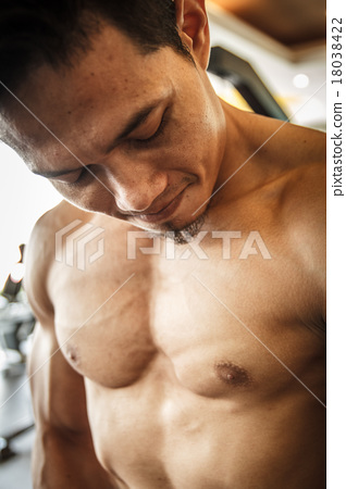 Stock Photo: Body Builder looking his muscle