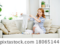 pregnant woman expectant mother prepares clothing items for newb 18065144