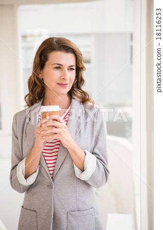 Casual businesswoman holding take-away cup 18116253