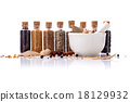 Assorted of spice bottles condiment . 18129932