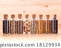 Assorted of spice bottles condiment . 18129934
