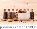 Assorted of spice bottles condiment . 18129935