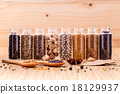 Assorted of spice bottles condiment . 18129937