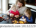 Father and his kids making chestnuts creatures 18132229