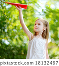 Adorable little girl holding a paper plane 18132497
