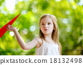 Adorable little girl holding a paper plane 18132498