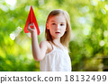 Adorable little girl holding a paper plane 18132499