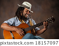 Passionate Afro Man Playing Guitar 18157097