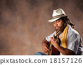 Passionate Afro Man Playing Guitar 18157126