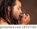 Afro Man Playing Harmonica 18157181