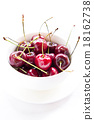 Cherries on white bowl isolated 18162738