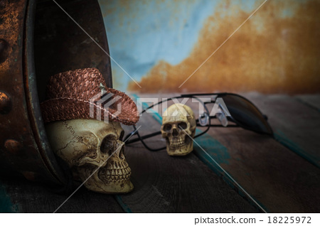 Skull cap in water tank on wooden 18225972