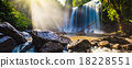 Tropical waterfall in jungle with sun rays 18228551
