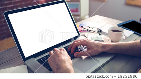 Stock Photo: Cropped hand of graphic designer using laptop