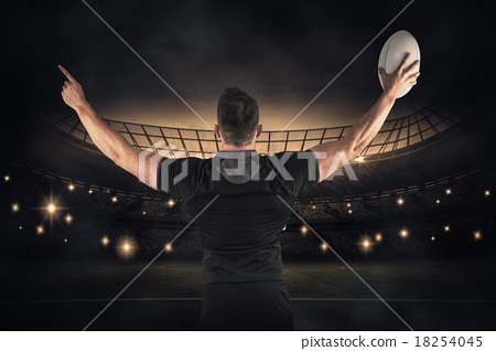 Composite image of rugby player celebrating with the ball 18254045