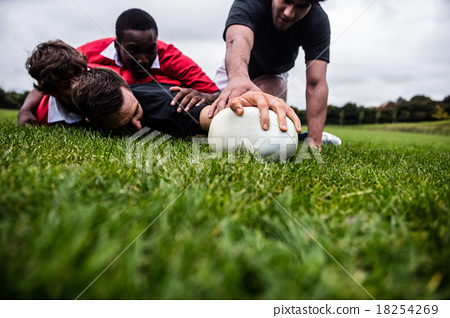Rugby players tackling during game 18254269