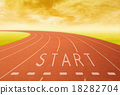 outdoor running track with sign start at sunset 18282704