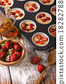 cooking berry muffins with fresh strawberries 18282788
