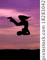 Silhouette of woman jumping 18283042