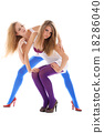 Two young woman in colour stockings 18286040