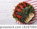 crayfish with herbs and lemon on a plate top view 18287060