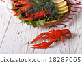 crayfish boiled with herbs on a table close-up 18287065