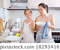Funny playful girl helping mother 18293416