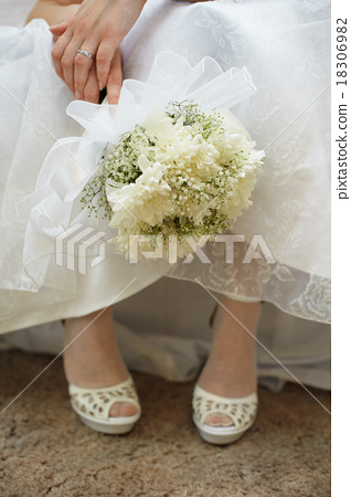 Bouquet of bride against dress and shoes 18306982
