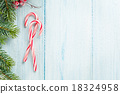 Candy cane and christmas tree on wooden table 18324958