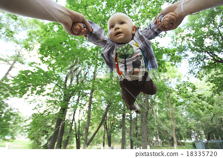 Dad playing with baby flying tosses summer 18335720