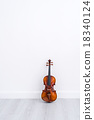 Classical cello on white wall background 18340124