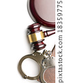 handcuffs and judge gavel 18359775