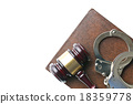 handcuffs and judge gavel 18359778