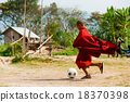 Monk in red robe playing football 18370398