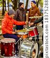 Performance of street musicians 18375288