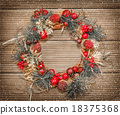 Christmas wreath on the wooden background. 18375368