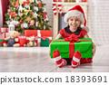 girl holding Christmas gift 18393691