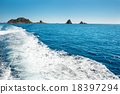 Waves on blue sea behind the boat 18397294