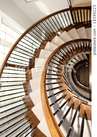 Closeup of a round staircase over three floor's 18399225