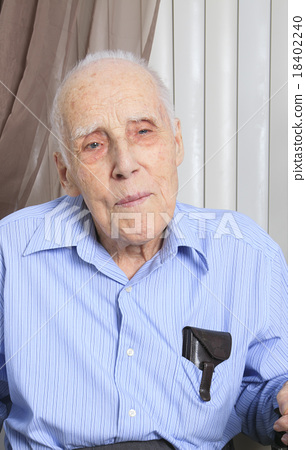 An old men smiling on his room 18402240