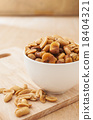 Peanut in a white bowl on wooden background 18404321
