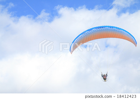Motor paraglider flying in the sky 18412423