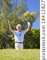 Happy senior man celebrating playing golf 18412827