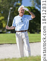 Senior man playing golf looking for his ball 18412831