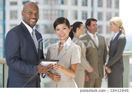 Stock Photo: Interracial business man woman team with tablet